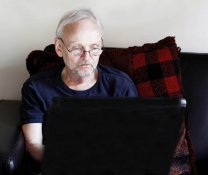 old man on a computer